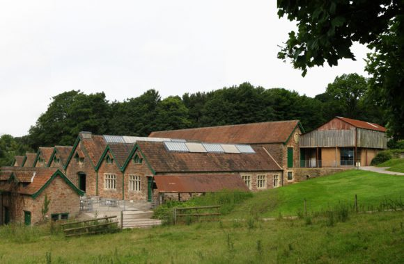 Home Farm with the reception building inside the old barn on the right